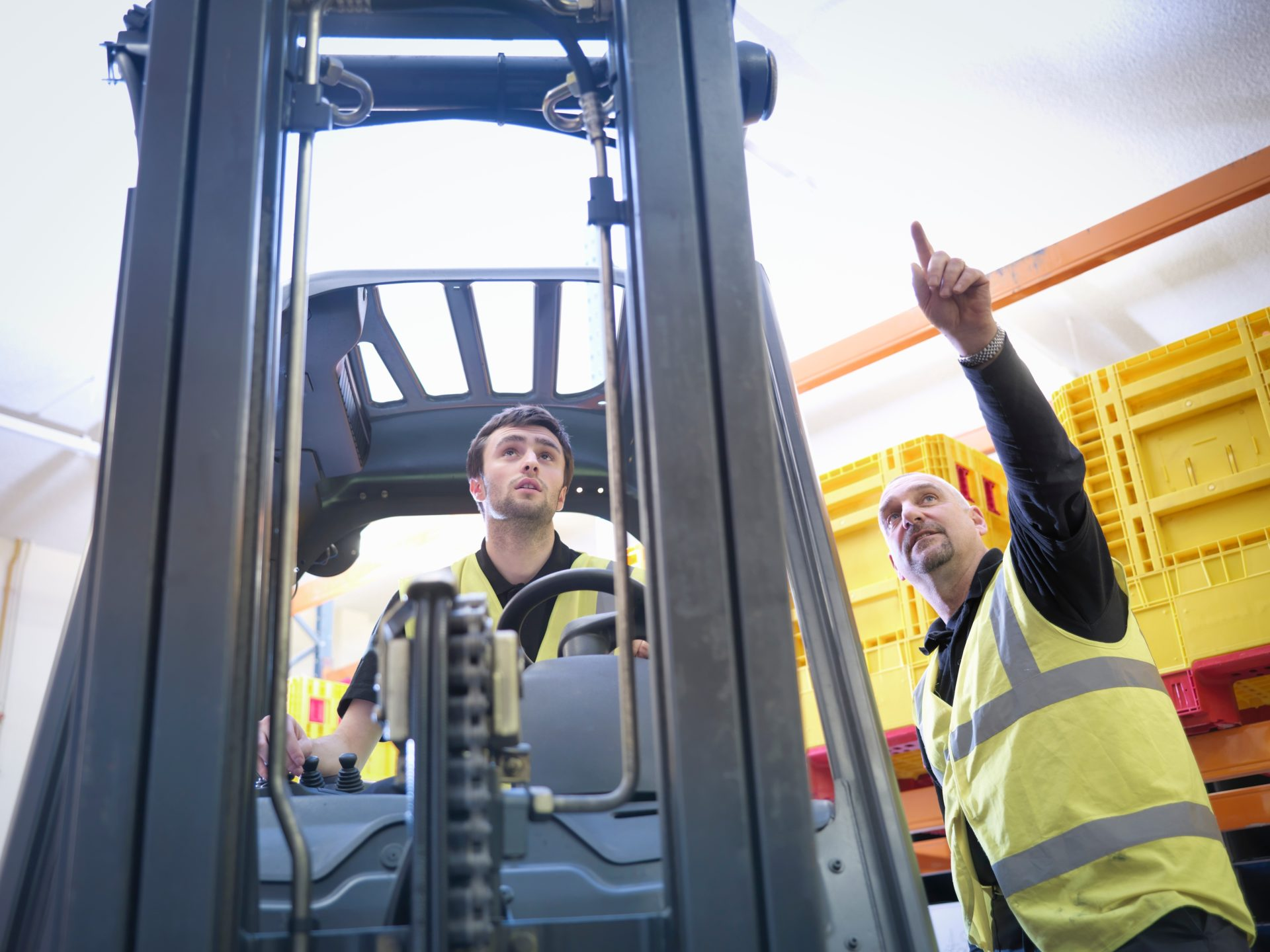 Trainer,Instructs,Male,Apprentice,On,Forklift,Truck