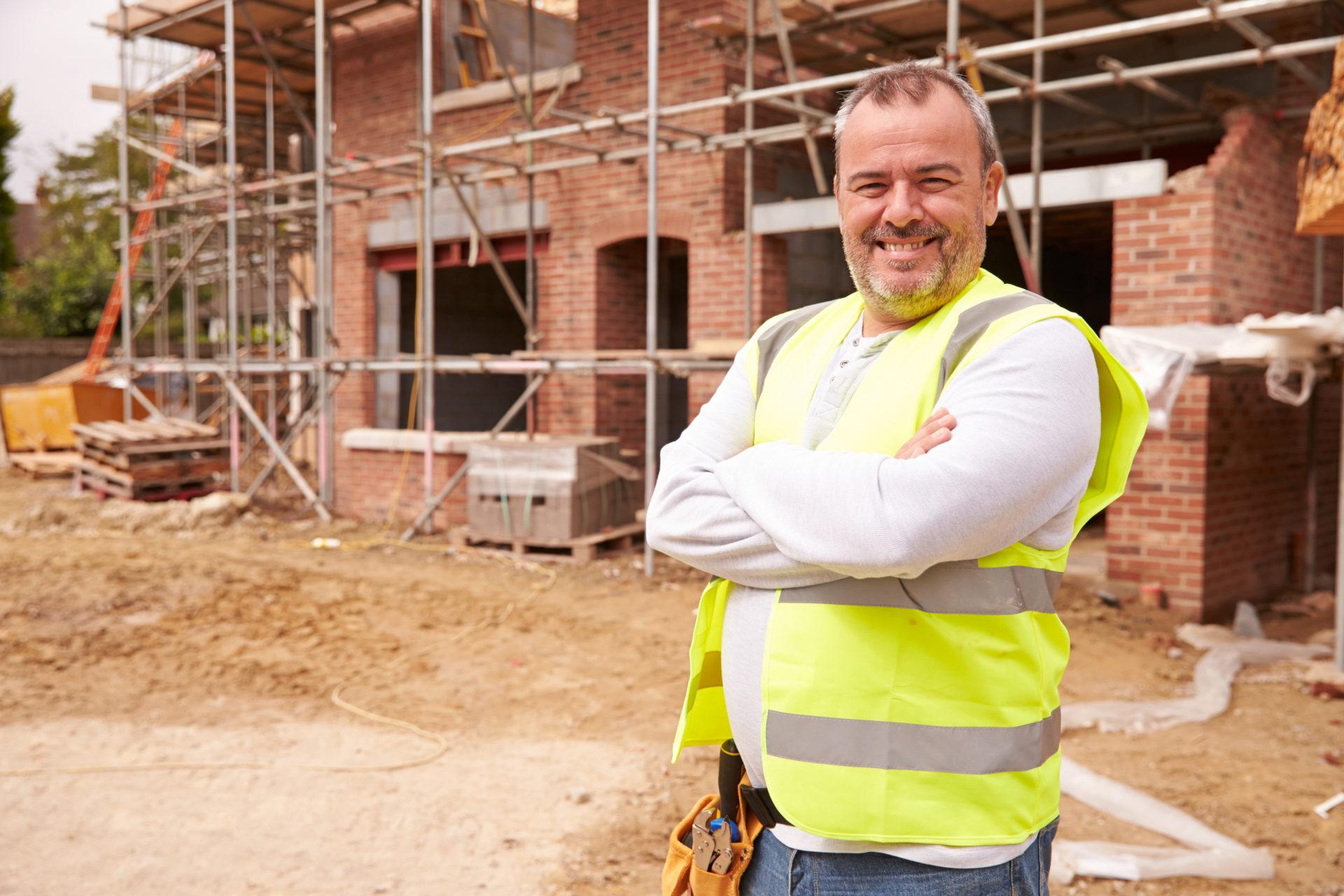 Portrait,Of,Construction,Worker,On,Building,Site